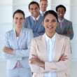 Smiling businesswoman leading her team — Stock Photo