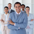Royalty-Free Stock Photo: Smiling businessman leading his team