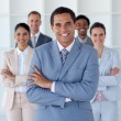Stock Photo: Smiling businessman leading his team