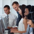 Manager helping his business team in a call center — Stock Photo