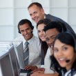 Royalty-Free Stock Photo: Manager with his business team working in a call center