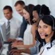 Business team working in a call center with a manager — Stock Photo
