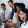 Businesswoman in a call center with her multi-ethnic team — Stock Photo #10280055