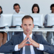 Manager sitting in call center in front of his team — Stock Photo
