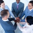 Smiling nternational business team with hands together — Stock Photo