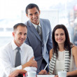 Royalty-Free Stock Photo: Business working together and smiling at the camera