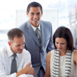 Young businessman working with colleagues — Stock Photo