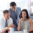 Young businesswoman working with colleagues — Stockfoto