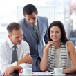 Stock Photo: Young businesswoman working with colleagues