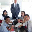 Business smiling in a meeting — Stock Photo