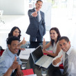 Business in a meeting with thumbs up — Stock Photo #10280346
