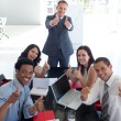 Business team in a meeting with thumbs up — Stock Photo
