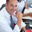 Businessmin meeting smiling at camera — Stock Photo #10280382