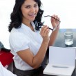 Smiling businesswoman with glasses in a meeting — Stock Photo #10280462