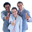 Close-up of happy business team with thumbs up — Stock Photo