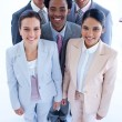 Royalty-Free Stock Photo: Happy multi-ethnic business team smiling at the camera