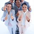Happy multi-ethnic business team with thumbs up — Stock Photo #10280548