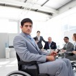 Stock Photo: Young businessmin wheelchair