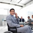 Smiling businessman on phone sitting in a wheelchair — Stock Photo
