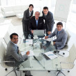 A diverse business team smiling at the camera — Stock Photo #10280607