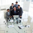 A business group showing diversity working at a computer — Stock Photo