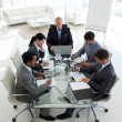 High angle of a senior manager in a meeting with his team - Stock Photo