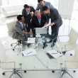 Multi-ethnic business looking at a document — Stock Photo