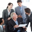 Multi-ethnic business discussing a contract — Stock Photo #10280653