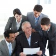 Senior manager showing sales report to his colleagues — Stock Photo