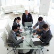 Multi-ethnic business team working together - Stock Photo