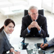 Stock Photo: Businesswomsitting at conference table