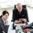 International business discussing a business plan — Stock Photo