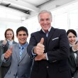 Happy multi-ethnic business team with thumbs up — Stock Photo