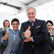 Stock Photo: Happy multi-ethnic business team with thumbs up