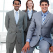 Stock Photo: Business in a line smiling at the camera