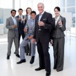 Multi-ethnic business toasting with Champagne — Stock Photo