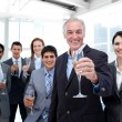 Happy diverse business group toasting with Champagne - Stock Photo