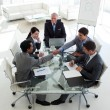 Businessmen closing deal in meeting — Foto de stock #10280760