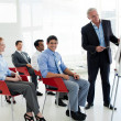 Portrait of a senior businessman giving a conference — Stock Photo