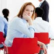 Young businesswoman bored at a conference — Stock Photo