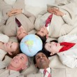 International business lying on the floor around a terres — Stock Photo