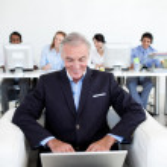 Senior businessman using a laptop — Stock Photo #10280952
