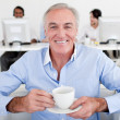 Senior businessman drinking a coffee — Stock Photo