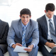 Stock Photo: Young Business sitting and waiting for a job interview