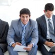 Young Business sitting and waiting for a job interview - Stock Photo