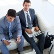Businessmen relaxing before job interview in waiting room — Stock Photo #10281108