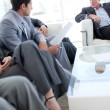 Business discussing in a waiting room — Stock Photo