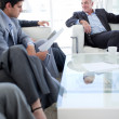 Multi-ethnic business discussing before a job interview - Stock Photo