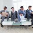 International business sitting in a waiting room — Stock Photo