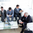 Stock Photo: International Business sitting and waiting for a job inte